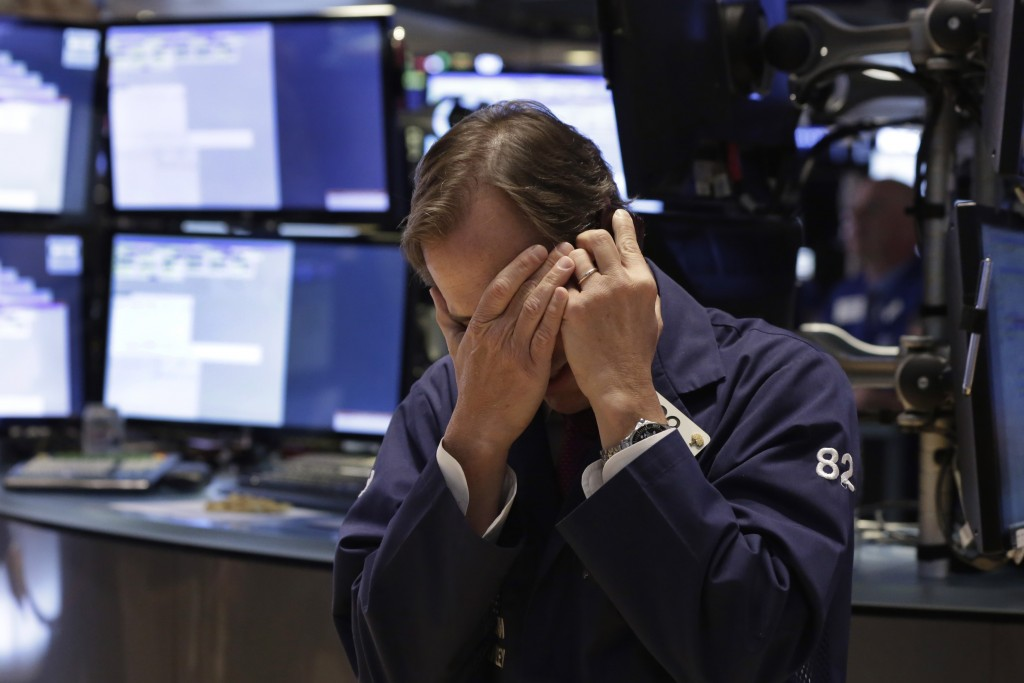 Trader Dudley Devine works on the floor of the New York Stock Exchange Thursday, May 21, 2015. U.S. stocks edged higher in early trading. Energy stocks rose more than the rest of the market as the price of oil climbed. (AP Photo/Richard Drew)